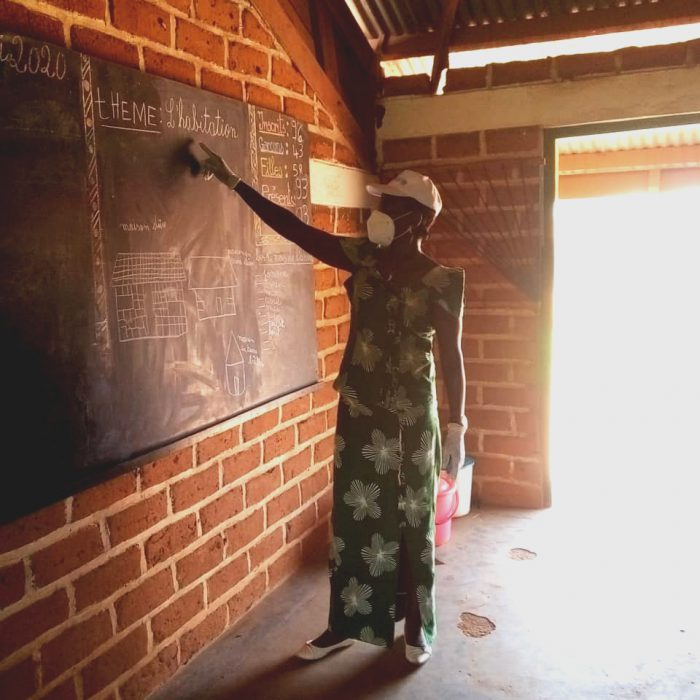 A teacher prepares the subject to record.